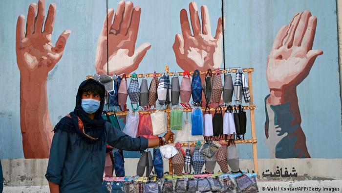 A street vendor selling face masks in Kabul