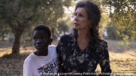 Sophia Loren and co-star, Ibrahima Gueye in a scene from The Life Ahead in an olive grove near Bari.