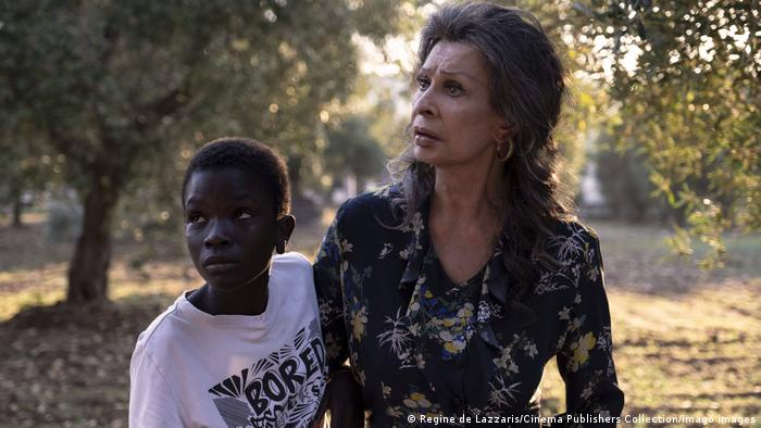 Sophia Loren and co-star, Ibrahima Gueye in a scene from The Life Ahead in an olive grove near Bari.