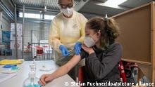 The German Red Cross rehearses the procedure for the vaccination of a corona vaccine in the vaccination center planned for the state of Baden-Württemberg