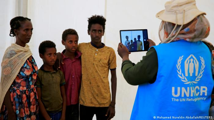A humanitarian worker from UNHCR documents Ethiopian refugees