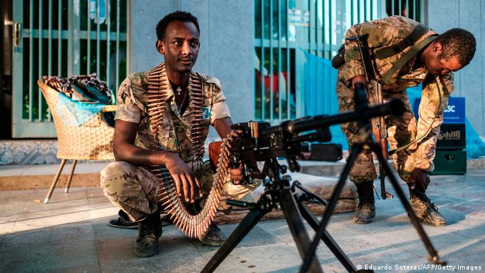 A member of the Amhara Special Forcessits next to a machine gun at an improvised camp in the front of a shop in Humera, Ethiopia, on November 22, 2020