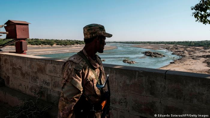A member of the Amhara Special Forces watches on at the border crossing with Eritrea, in Humera, Ethiopia