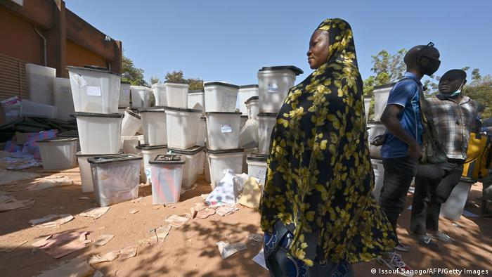 A woman walks past ballot boxes in Burkina Faso