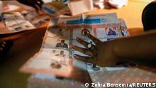 Electoral workers count the ballots at a polling station following the presidential and legislative election in Ouagadougou, Burkina Faso, November 22, 2020. REUTERS/Zohra Bensemra