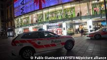 Police cars parked outside a Manor department store in Lugano