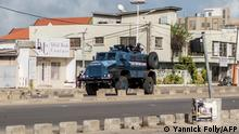 An armoured vehicle of the Republican police patrols in the streets of Cadjehoun, district of former president of Benin Thomas Boni Yayi, on May 1, 2019 in Cotonou. - Protestors in Benin set up burning barricades on the streets on May 1, as soldiers encircled the home of ex-president Thomas Boni Yayi after he led calls for an election boycott. Hours after initial results showed a record low turnout in Sunday's controversial parliamentary polls, soldiers in tanks were posted on the main roads leading to Boni Yayi's home in the economic capital Cotonou. (Photo by Yanick Folly / AFP)