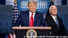 President Donald Trump, joined by Vice President Mike Pence, delivers brief remarks on the stock market and the Dow reaching 30,000 for the first time in history, at the White House in Washington, DC on Tuesday, November 24, 2020. PUBLICATIONxINxGERxSUIxAUTxHUNxONLY WAP20201124320 KEVINxDIETSCH