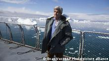 John Kerry standing in front of the Jakobshavn Glacier in Greenland