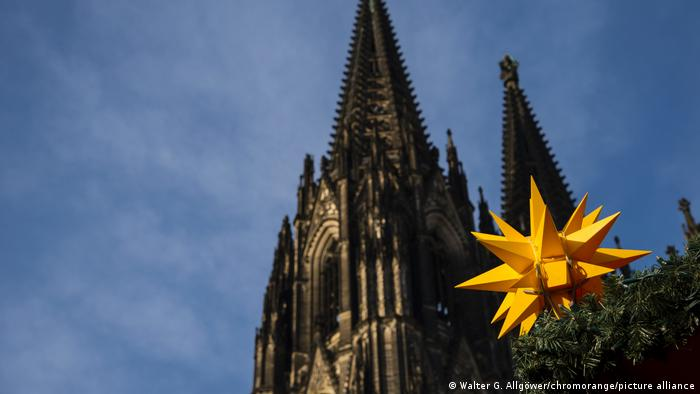 Cologne Cathedral and a yellow star ornament