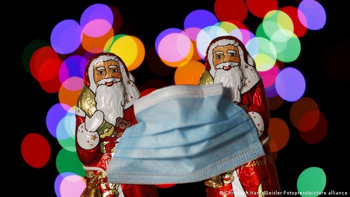 Chocolate Santas wear masks
