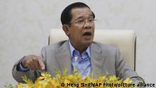 FILE - In this Jan. 30, 2020, file photo, Cambodia's Prime Minister Hun Sen gestures during a speech on the current state of a new virus from China in Phnom Penh. A Cambodian court began Thursday, Nov. 26, hearing the cases of nearly 130 opponents and government critics charged with treason for taking part in nonviolent political activities over the past three years. (AP Photo/Heng Sinith, File) |