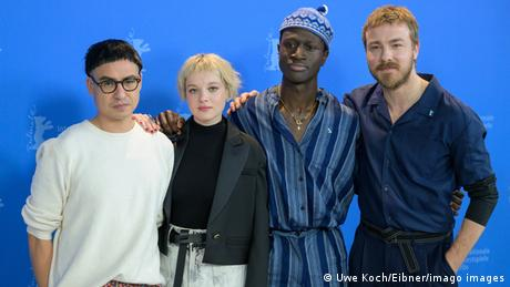 Three men and a woman, the team of the film Berlin - Alexanderplatz, Burhan Qurbani, Jella Haase, Welket Bungue and Albrecht Schucht, pose for the camera