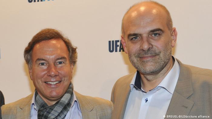 Nico Hofmann und Joachim Kosack vor einer Ufa-Fotowand