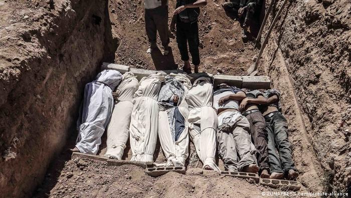 A mass grave with the bodies of those killed in a sarin gas attack on eastern Ghouta in 2013