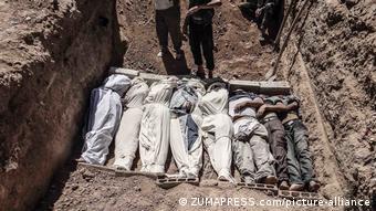 Μαζικός τάφος στην Γκούτα της Συρίας, 2013