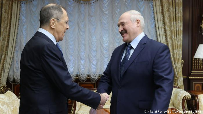 Lavrov shakes hands with Lukashenko in Minsk