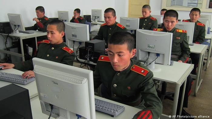 Students at the Mangyongdae Revolutionary School, in Pyongyang, North Korea work on computers.