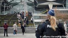 People wait to enter the court building in Antwerp, Belgium