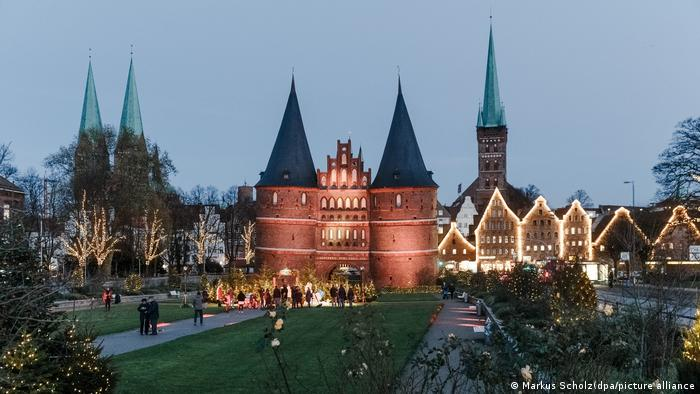 The Holstentor Gate in Lübeck with seasonal Christmas lighting