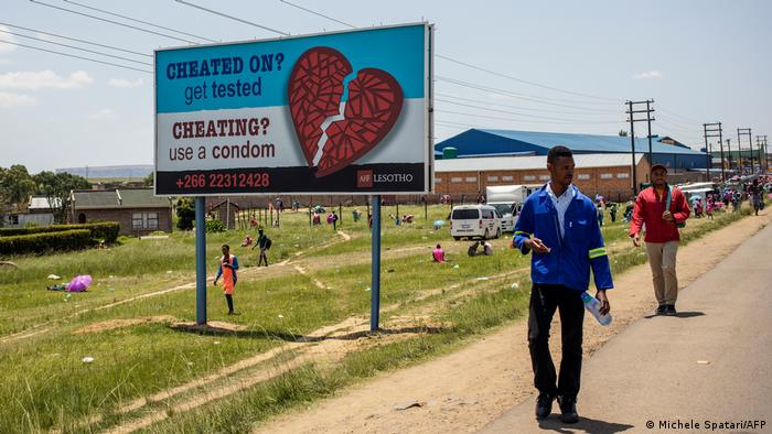 Cheating? reads a billboard in Lesotho. Use a condom.