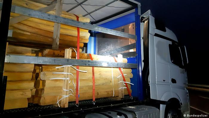 A truck carrying tree trunks that several migrants hid in as they were smuggled across the German border