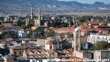 April 20, 2019 - Nicosia, Cyprus - On April 22 2019, the Selimiye mosque and the Phaneromeni Church rise on opposite sides of the capital city of Cyprus, Nicosia, or Lefkosa in Turkish, which remains divided by a United Nations green line following the 1974 occupation of Turkish forces in Northern Cyprus. Today, it is a dynamic city with Turkish Cypriots living in it s northern half and Greek Cypriots living in the southern half. While reunification talks continue, many Cyprus citizens and tourists cross the buffer zone on a daily basis to conduct business and shopping. Nicosia Cyprus PUBLICATIONxINxGERxSUIxAUTxONLY - ZUMAn230 20190420_zaa_n230_1585 Copyright: xDiegoxCupolox