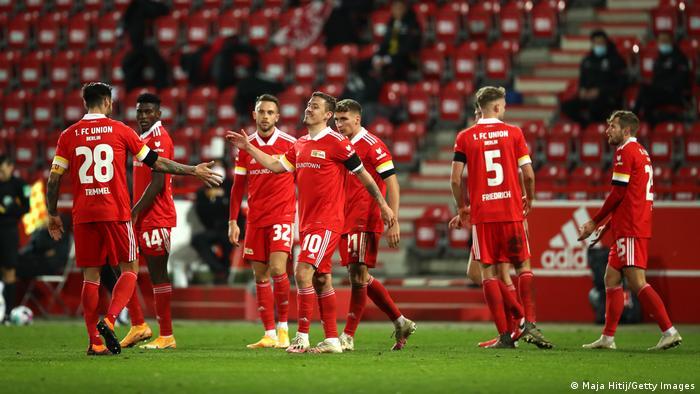 Union Berlin's Max Kruse celebrates after scoring against Eintracht Frankfurt