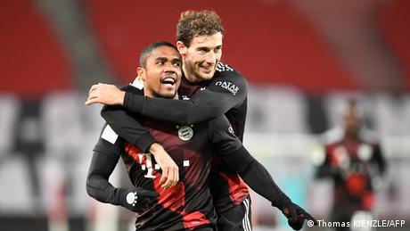 Douglas Costa and Leon Goretzka celebrate Bayern Munich's third