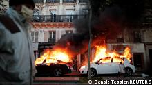 Cars burning following protests in Paris