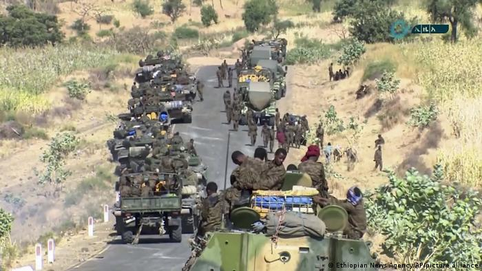 Ethiopian military gathered on a road in an area near the border of the Tigray and Amhara regions of Ethiopia
