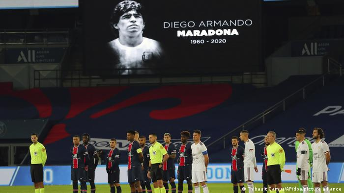 French players holding a minute's silence as Maradona's face appears on a large screen