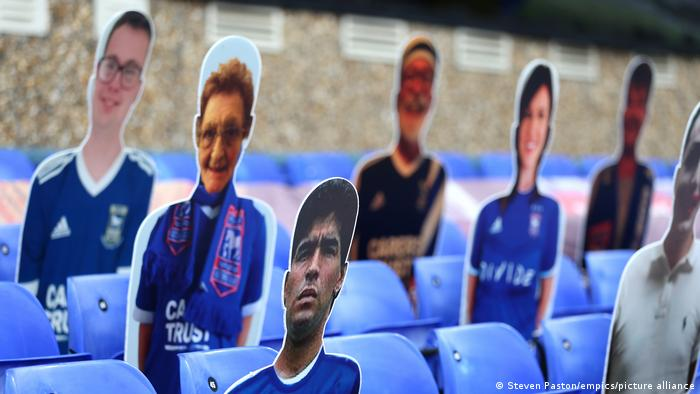 A cutout of Maradona appears in Ipswich Stadium among cut-outs of other fans