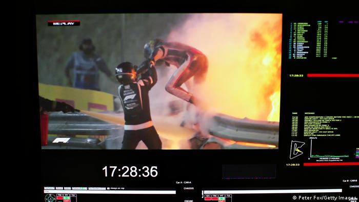 Romain Grosjean of France and Haas F1 is pictured on a screen escaping his crash