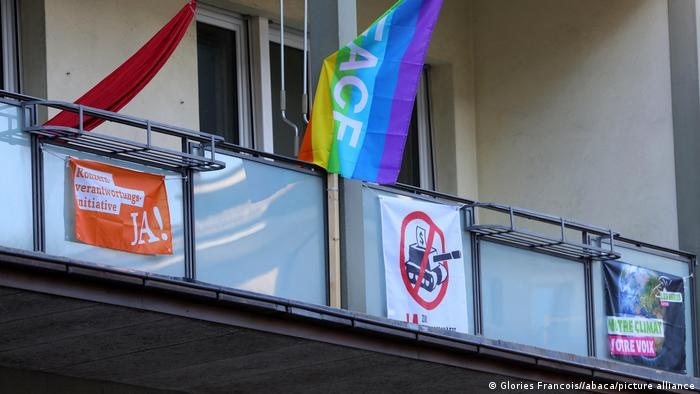 Posters about the referendum hang from a balcony in Bern