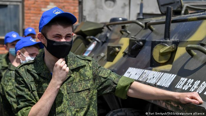 Army conscripts in face masks take part in a training session at the Ussuriysk Technical School