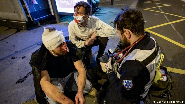 Street medics tend to Syrian freelance photographer Ameer Al Halbi who was injured during clashes at a protest against police brutality in Paris, France