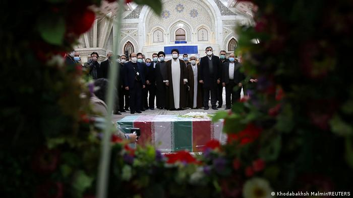 Mourners pay tribute next to the coffin of Iranian nuclear scientist Mohsen Fakhrizadeh