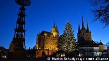 Erfurt Germany, city center place in front of the church with festively lit christmas tree
