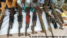 A picture shows weapons, allegedly belonging to a group of suspected Boko Haram militants, displayed by the police officers, in Maiduguri, northeast Nigeria, on July 18, 2018. - Eight men have been arrested in connection with Boko Haram's abduction of more than 200 schoolgirls from the remote town of Chibok in northeast Nigeria, police said on July 18, 2018. The 14 others were alleged to have been involved in logistics and planning suicide bomb attacks. (Photo by Audu Ali MARTE / AFP) (Photo credit should read AUDU ALI MARTE/AFP via Getty Images)