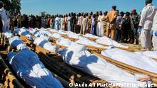 Mourners attend the funeral of 43 farm workers in Zabarmari, about 20km from Maiduguri, Nigeria, on November 29, 2020