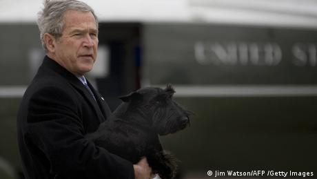 President George W. Bush holds his dog Barney