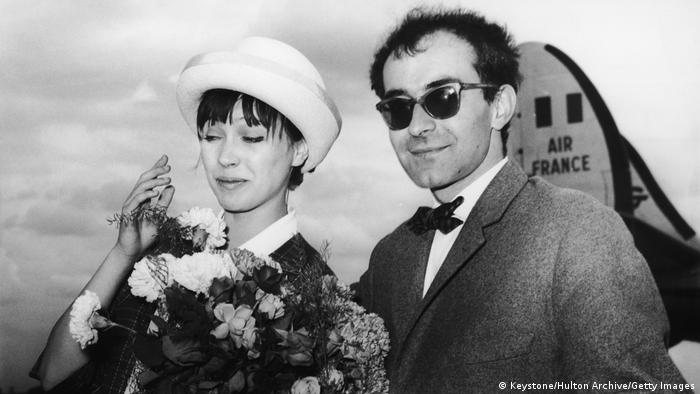 Jean-Luc Godard and his wife Anna Karina in front of an Air France plane.