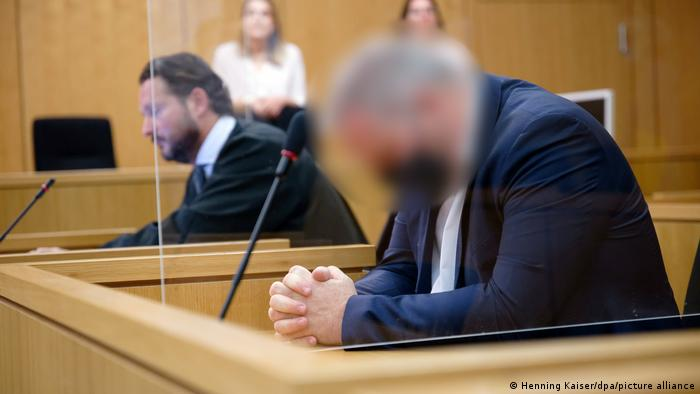Blurred picture of the accused at the trial