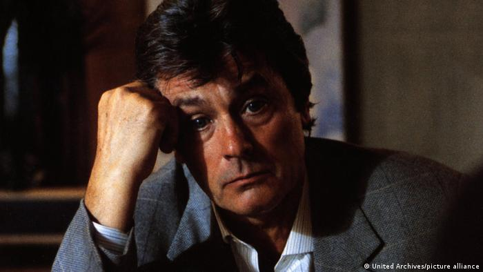 French actor Alain Delon looks into the camera