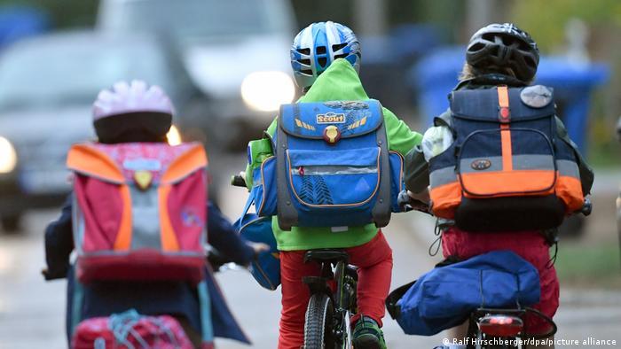 Children on their way to school by bike