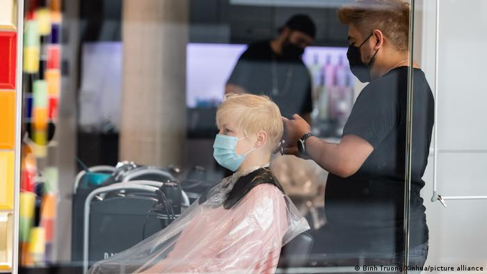 A person getting a hair cut at a salon in Berlin