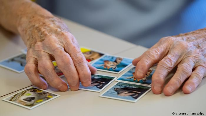 A patient in a care home playing 'Memory'