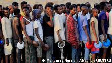 Ethiopian men who fled war in Tigray region, queue for wet food ration at the Um-Rakoba camp, on the Sudan-Ethiopia border in Al-Qadarif state, Sudan November 19, 2020. REUTERS/Mohamed Nureldin Abdallah TPX IMAGES OF THE DAY