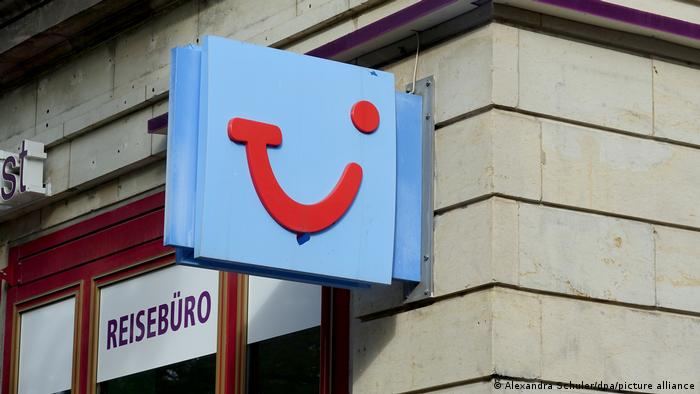 The TUI logo on a sign at a travel agency. Undated file photo.
